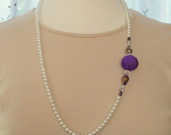 """White pearl necklace with a purple mesh ball, crystal and purple bead accents 29"""""""