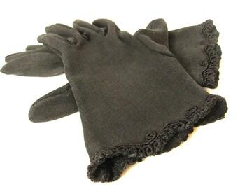 Vintage black knit wristlet gloves with gimp trim. Size small