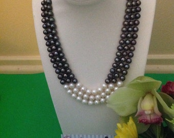 Beautiful triple stand black and white freshwater pearl necklace