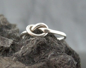 RING, STERLING SILVER  Ring Love Knot Shaped with Flowing Lines and Edges, Cast Lost Wax Method, High Polished Finish.