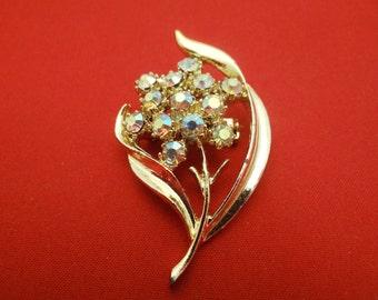 "Vintage 2"" gold tone flower brooch with sparkling aurora borealis rhinestones, great condition, appears unworn"