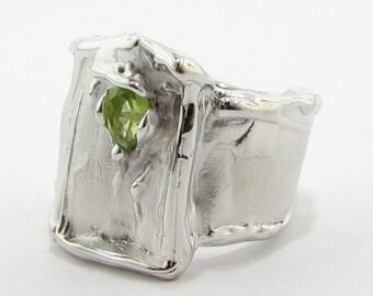 Silk: Silver and Peridot Wide Band Ring