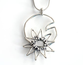Water lily pendant in solid sterling silver , lotus flower necklace , lilly pad jewelry by Canadian jewellery artist Melissa Pedersen