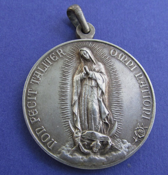 Virgin of guadalupe medal