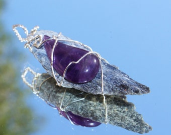 Kyanite Blade with an Amethyst Rain Drop Wrapped in Silver