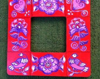 Red, pink and purple floral painted wooden frame