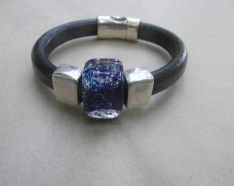 Handmade Americano Boro Glass Slider Bead for Regaliz is on this bracelet.