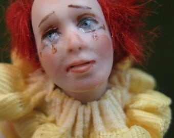 Sad porcelain Miniature Circus Clown doll sculped by artist Kay Brooke