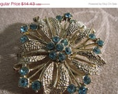 March Sale Vintage Rhinestone Brooch, Soft Blue Crystals Set in and around Gold-Tone Petals - circa 1950s  -  Flat Rate Shipping