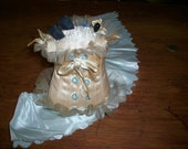 Corset antique pincushion made of vanilla silk satin with pale robin's egg blue lacing grommets