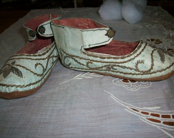 These Child's shoes (or very large doll) with leather soles in  good condition may be as old as 1700s