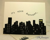 Cityscape in layers of black and grey with whimsical message, It's your birthday""