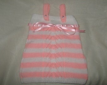a childs pink and white striped sun dress