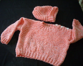 Hand knit orange and white pullover sweater and hat