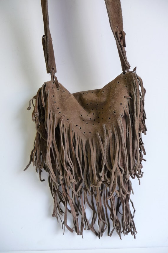 Shop brown leather fringe purse from Bottega Veneta, Chloé, Prada and from Farfetch, TheRealReal, Vestiaire Collective and many more. Find thousands of new high fashion items in one place.