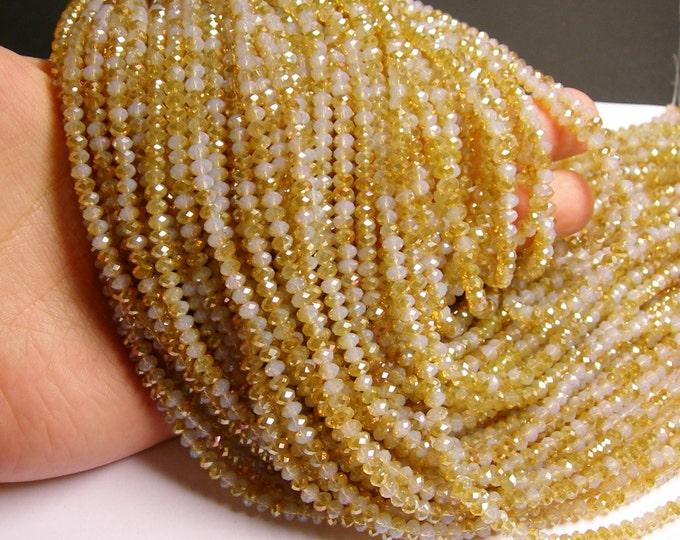 Crystal faceted rondelle - 100 pcs - full strand - 4 mm - A quality - ab finish - sparkle yellow topaz - FCRM4