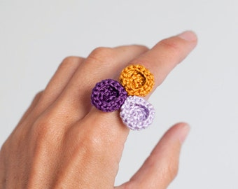 Crocheted ring. Mustard, violet and lavender. Crocheted circles ring. Textile jewelry. Organic forms. Crochet Jewelry. Romantic Jewelry.