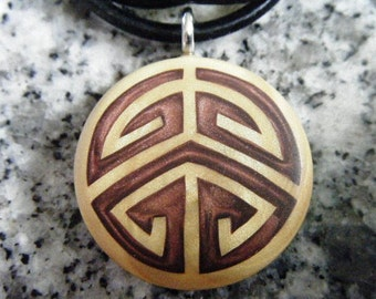 Puzzle hand carved on a polymer clay light gold pearl color background. Pendant comes with a FREE 3mm Necklace