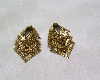 Vintage Sarah Coventry Gold tone filigree.. triple layered leaves.. Patent Pending..clip earrings