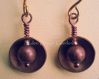 Domed brass and copper earrings with gold ear wires