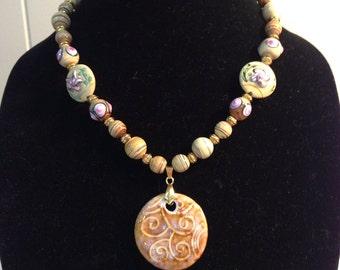 Taupe ceramic pendant with ceramic beads