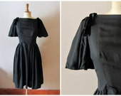 vintage 1950s cotton and velvet BOWS black dress / early 50s bell sleeves dress