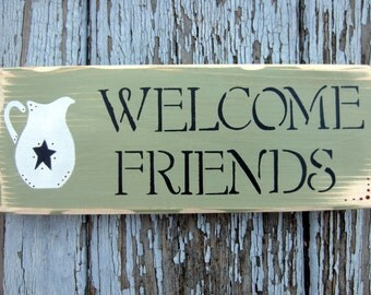 Welcome Friends with pitcher sign