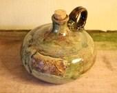 XXX Moonshine/growler jug.