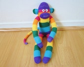Rainbow sock monkey plush doll with red heart and wide jewel toned rugby stripes