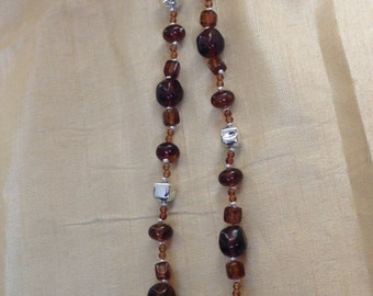 "Vintage amber and silver beaded necklace.  29"" end to end"