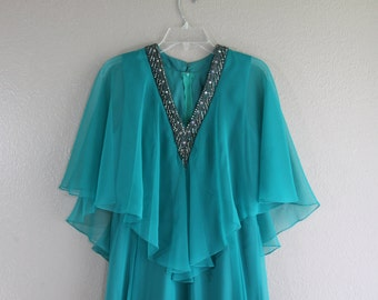 perfect teal vintage dress with wing sleeves and deep plunge neckline CHIC