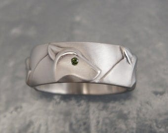 silver wolf band with diamond eyes.  pick your color