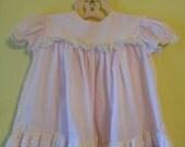 Pale pink vintage baby dress