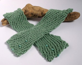 Women's or teenager hand knitted orchard green lacy wrist warmers / fingerless gloves.