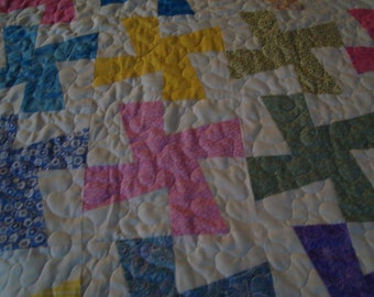 Infant windmill quilt done in various colors
