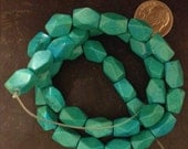 4 Strands: Facted Turquoise beads