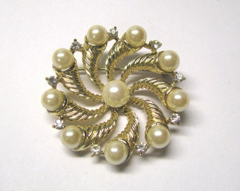 Vintage Ivory Faux Pearl Crystal Rhinestone Swirl Round Brooch in Gold tone Metal, Signed Coro.