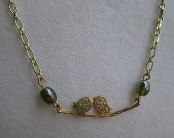 Gold tone necklace, love birds necklace, swarovski crystal necklace, fashion necklace.