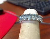 Custom Palladium and sky blue topaz eternity band