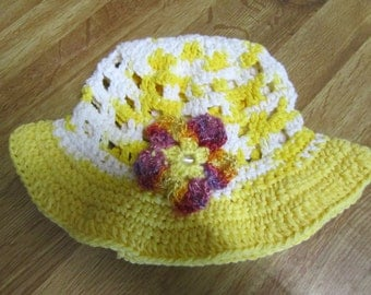 Girl's crocheted hat with removable hair clips.