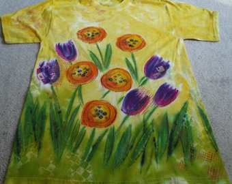 Simple, colorful tulips and orange flowers, man's medium hand painted t-shirt with procion dyes, later discharged using thermo fax screens