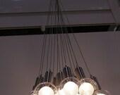 Stunning modern pendant light chandelier with 15 glass globes . New.