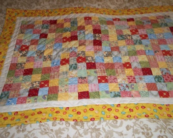 doll size quilt in 1 inch patchwork.