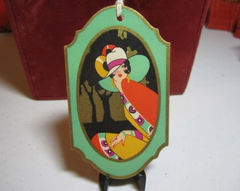 1920's-30's unused art deco gold gilded Gibson bridge tally card colorful bobbed hair lady in deco fashions stylized deco trees