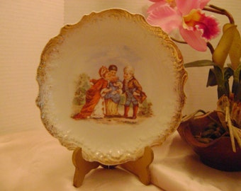Antique plate with children.