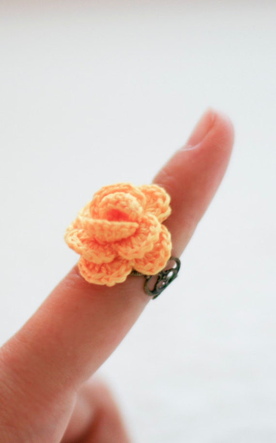 adjustable antique bronze plated ring with bright yellow flower