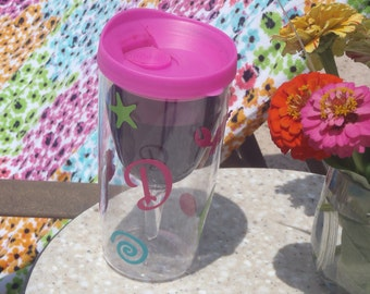 Insulated BPA free acrylic wine glass decorated with your design or ours has different colored lids