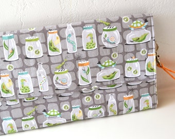 All In One Changing Pad and Diaper Clutch in Grey Bug Jars