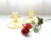 Pair of yellow depression glass candle holders
