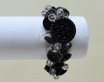 Handmade button bracelet made with Victorian black glass buttons and crystal bead dangles on silver chain